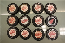 Detroit Red Wings 1955 Cup Lot of 12 Autographed Pucks (A)