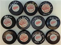 1970s Detroit Red Wings Autographed Puck Lot
