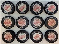 1950s Red Wings Cup Winners Autographed Puck Lot