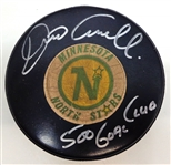 Dino Ciccarelli Autographed North Stars Game Puck